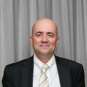 GEORGE V. SAROGLOU